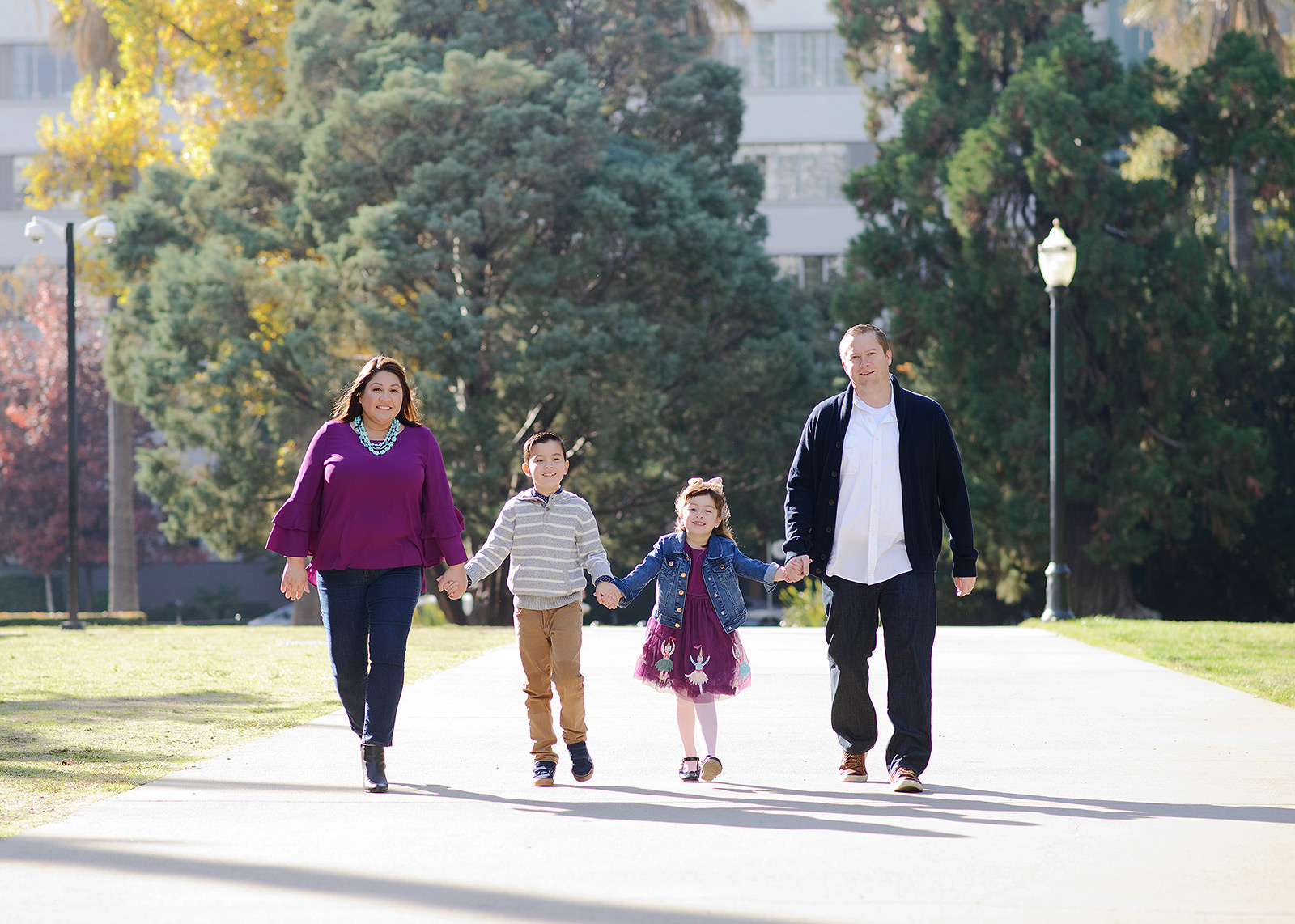 Family walking outside in Sacramento State Capitol