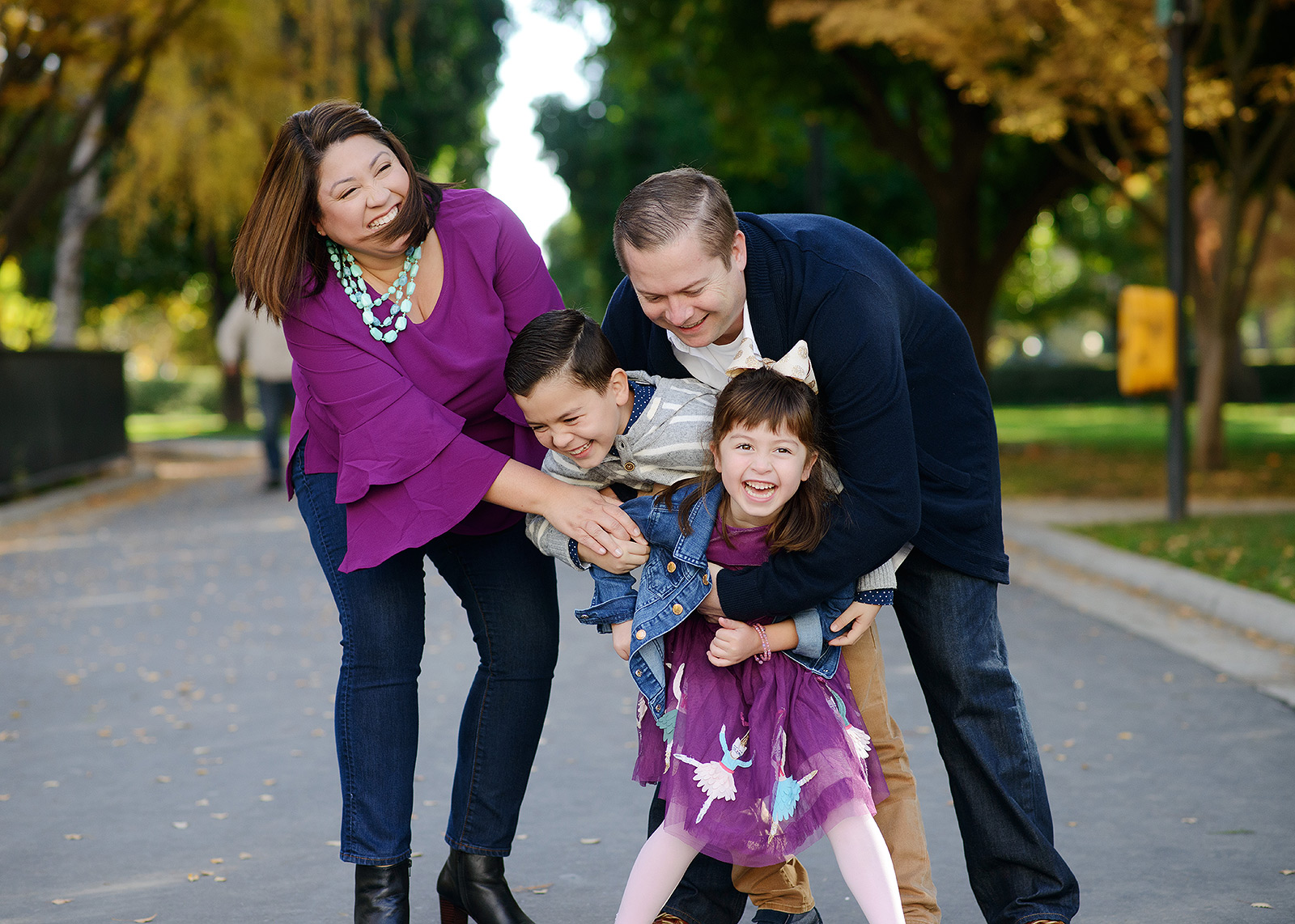 Family having fun and laughing outside State Capitol during the fall