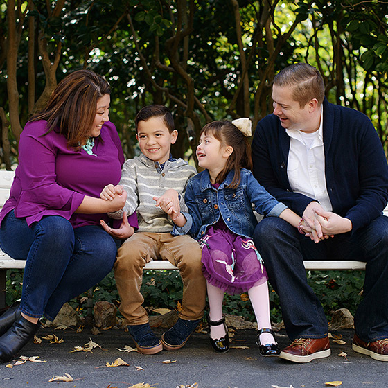 Family photo on bench at Sacramento State Capitol