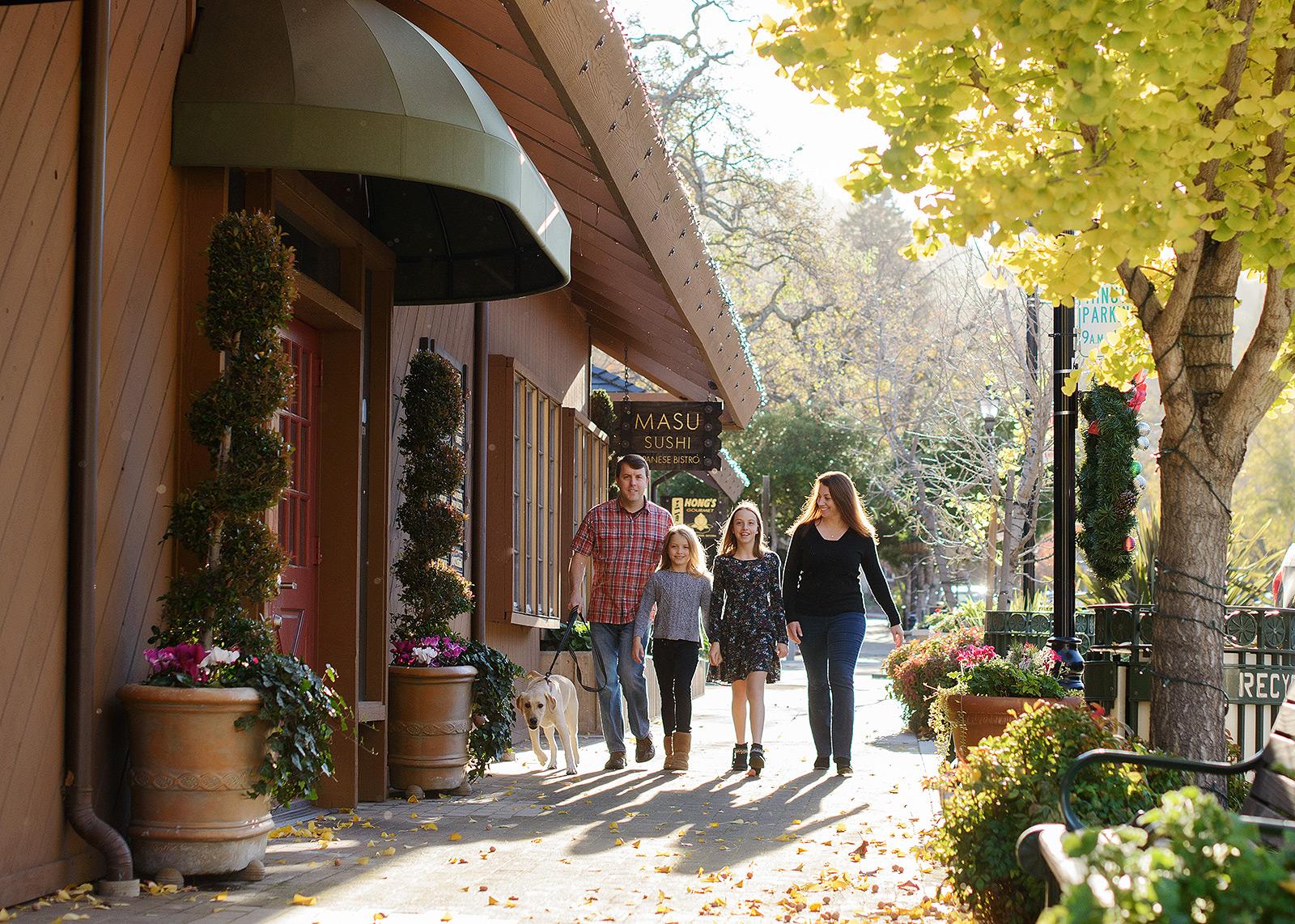 Family walking through Saratoga street in the fall