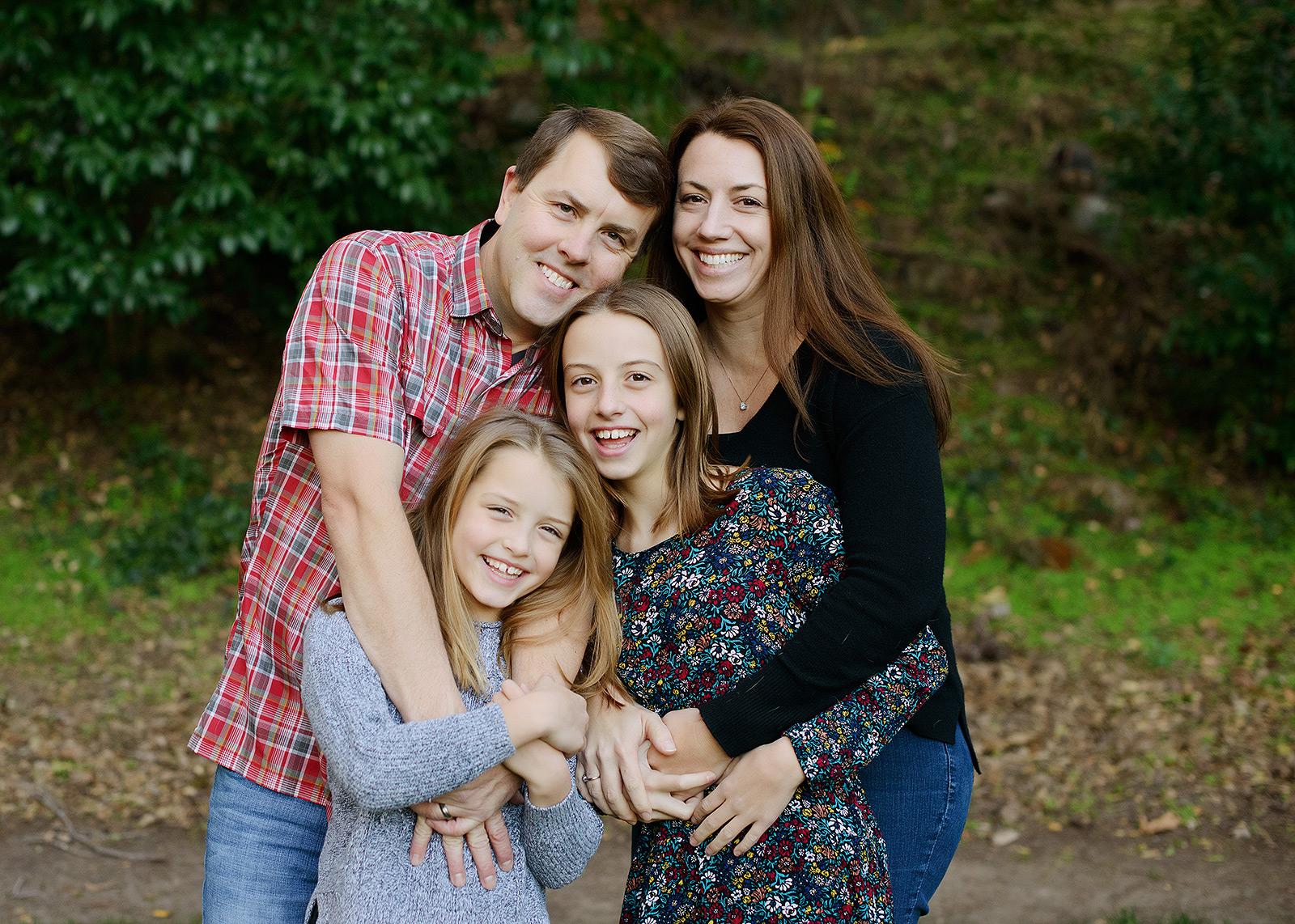 Family photo outdoors in Saratoga fall