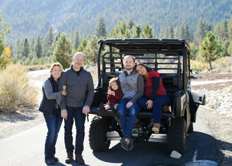Family photo by the jeep outdoors in Nevada fall