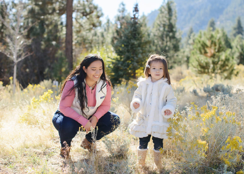 Mom and daughter in golden grass and wildflowers in Nevada