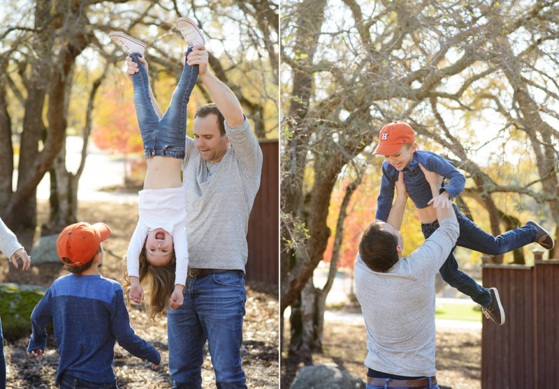Dad lifting daughter upside down and lifting son in air with Sacramento tree foliage