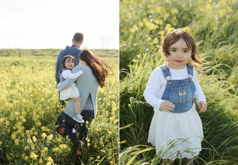Toddler girl wearing yellow flower crown in middle of green field in West Sacramento