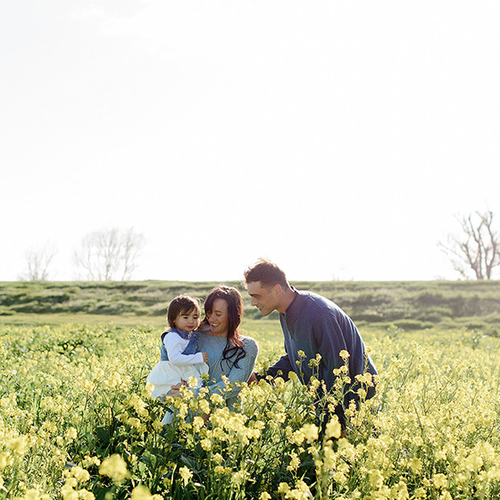 Family in the middle of yellow wildflower field in West Sacramento