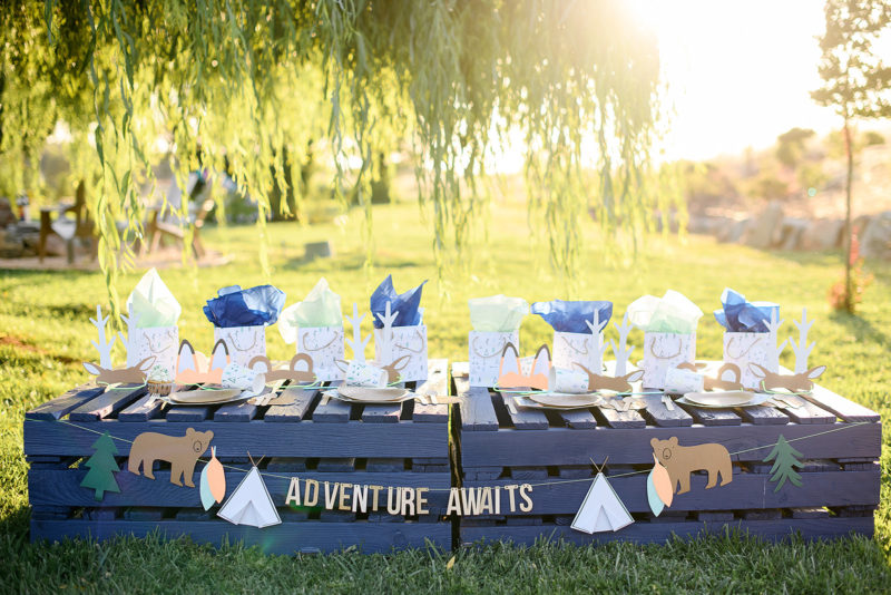 Camping tablescape with teepee gift bags and animal ears