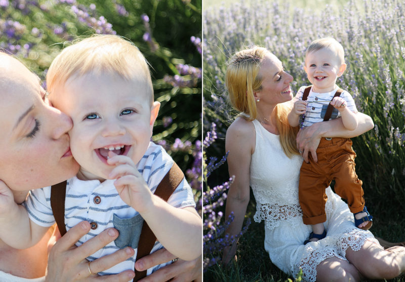 Sacramento photographer, Jill Carmel, photographing one year old boy smiling as mom gives him a kiss in lavender field