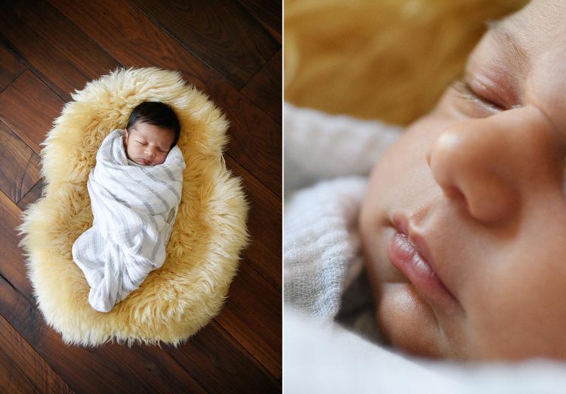 Newborn baby lying on sheepskin rug on hardwood floor
