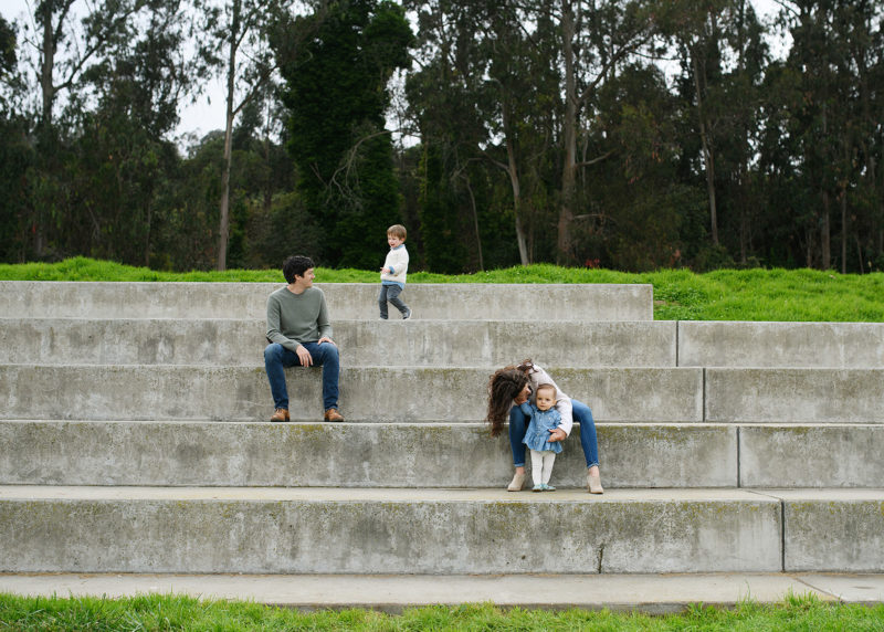Family scattered along steps in San Francisco