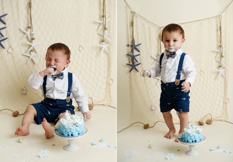 Baby boy crying while eating cake during nautical themed cake smash in Sacramento photography studio