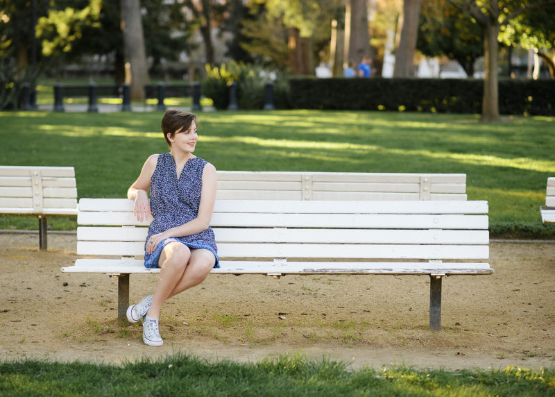 High school senior sitting on bench outside of State Capitol