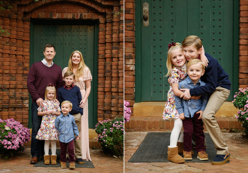 Family photo in front of green door and brick exterior in Grass Valley