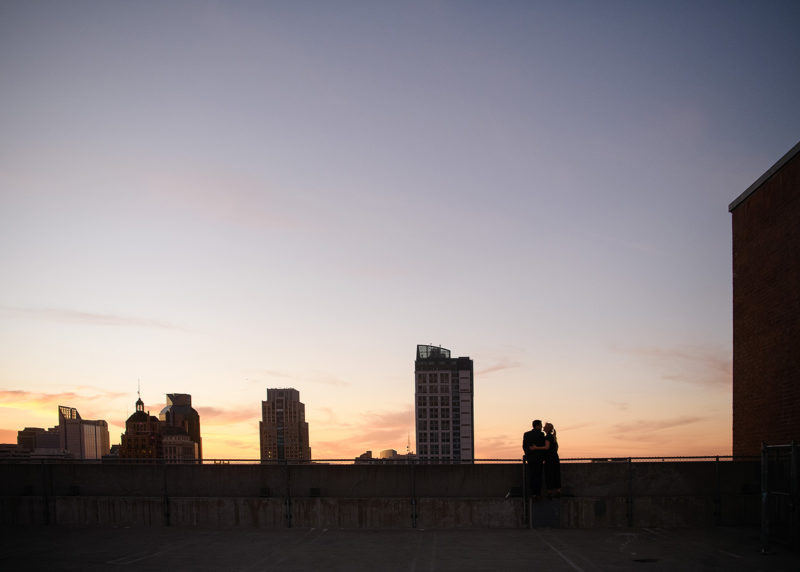 Couple hugging silhouette during sunset at Downtown Sacramento rooftop