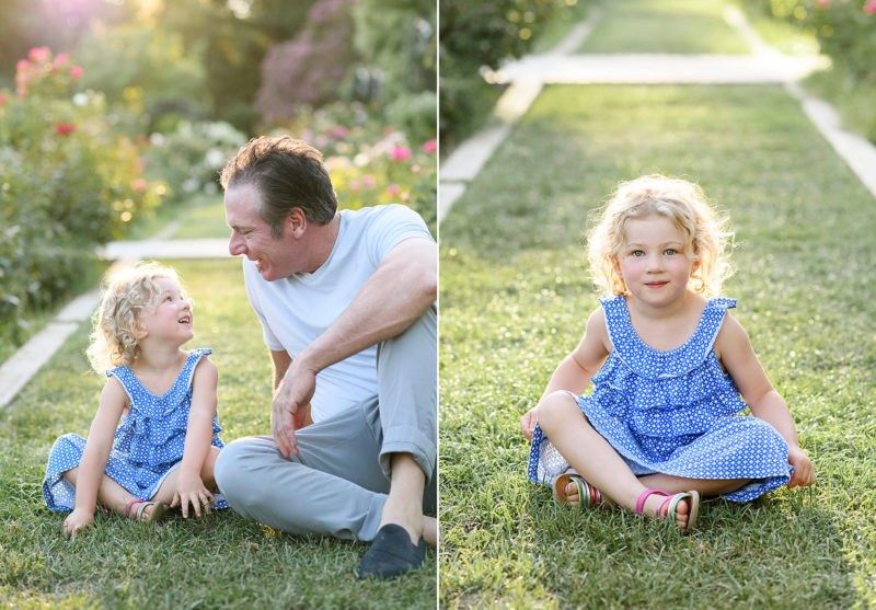 Uncle and niece looking at each other and sitting on the grass in McKinley Park Sacramento
