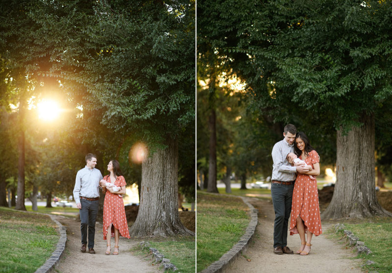 Mom and dad walking along Sacramento park path while holding newborn baby boy during sunset