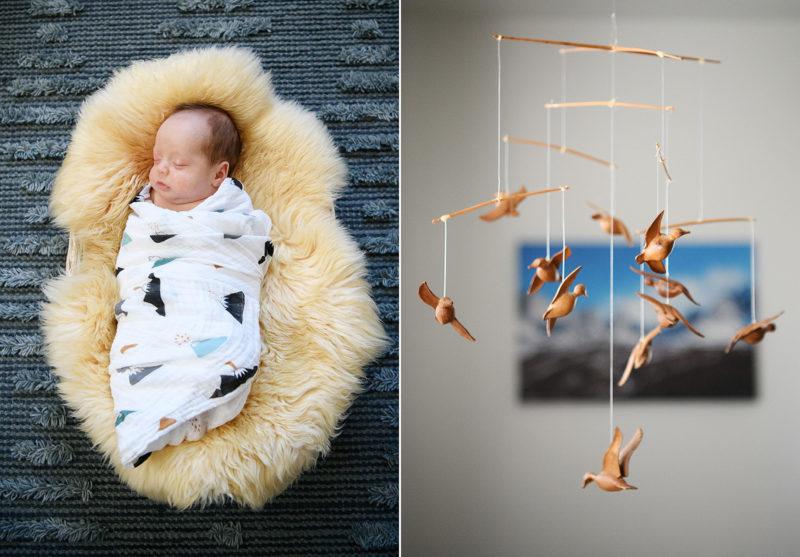 Newborn baby boy sleeping on sheepskin rug and close up of wooden bird mobile in nursery in Sacramento