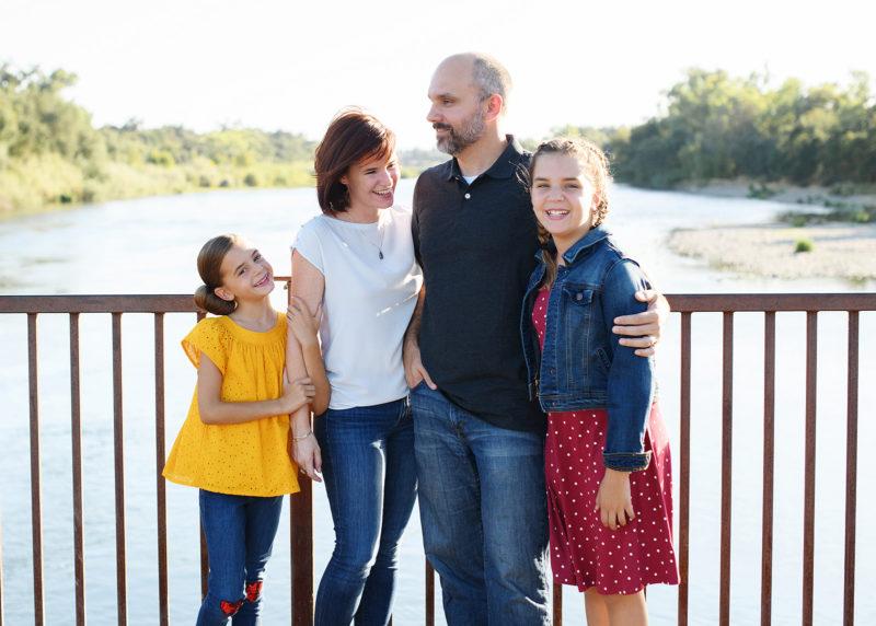 fun family photography taken on a bridge in fair oaks sacramento