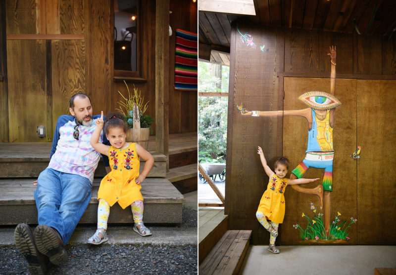 Daughter being silly and copying mural on home and striking a pose with dad in Mendocino home