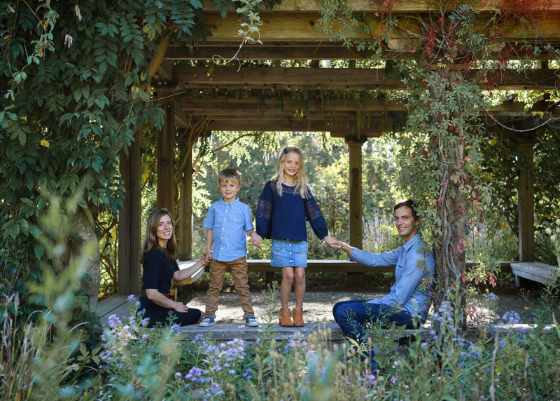 Family photo in pergola with crawling vines in Quarryhill Botanical Garden Sonoma