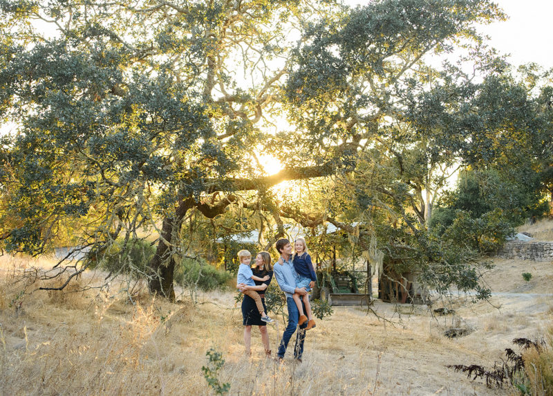 Family photo during sunset among big trees in Quarryhill Botanical Garden in Glen Ellen Sonoma
