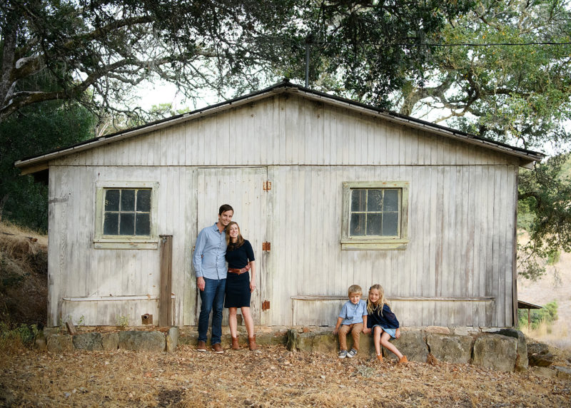 Family photo in whitewashed wooden shed in Quarryhill Botanical Garden Sonoma