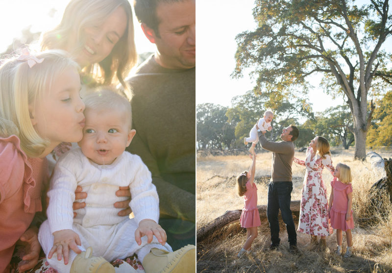 Big sister kissing baby brother as he drools and dad lifting him up in the air in Folsom outdoors