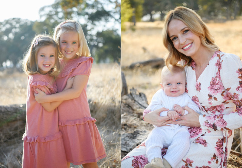 Twin sisters wearing pink dresses hugging and mom and baby smiling in Folsom park
