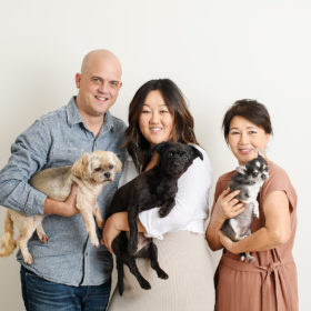Husband, pregnant wife and mom all holding dogs and smiling in Sacramento studio