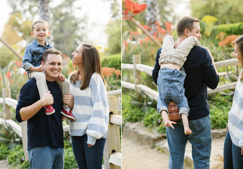 Dad holding son on shoulders and holding him upside down as mom watches in Sacramento park