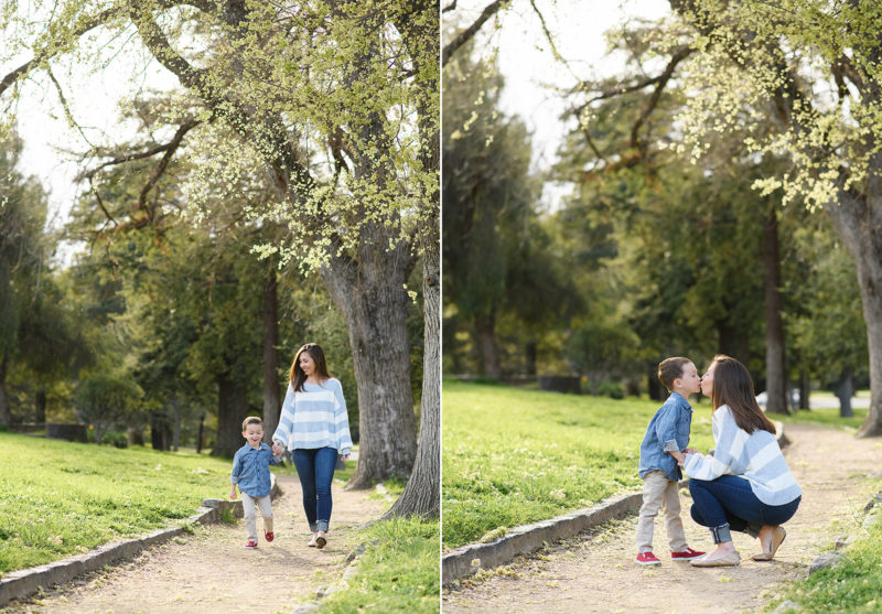 Mom and son walking through Land Park among tall Oak trees