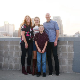 Family photo overlooking Sacramento skyline on a rooftop