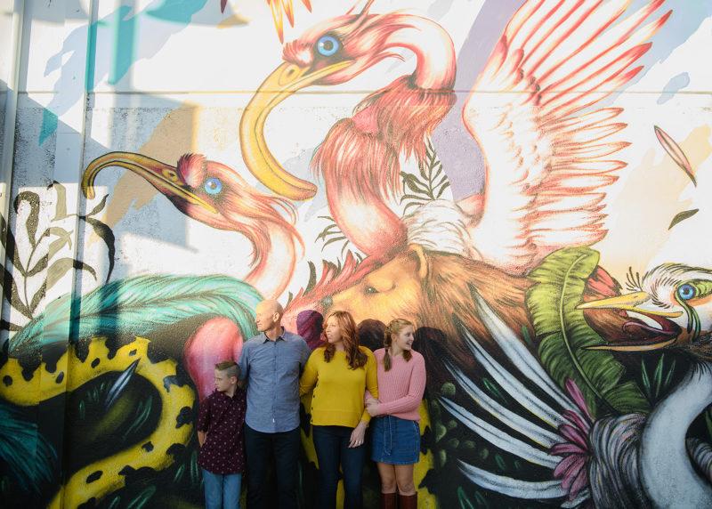 Family photo in front of Mateus Bailon mural in midtown Sacramento