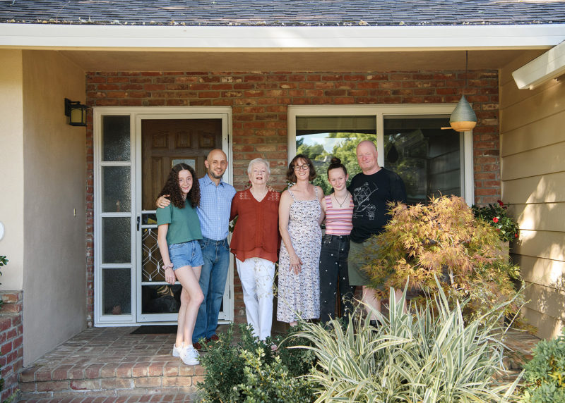 Family reunion portrait in front of house entrance in Sacramento