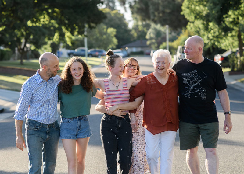 Family walking down the street and holding hands in Sacramento