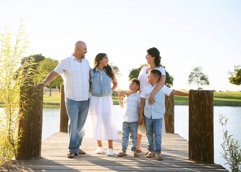 Family smiling at each other on dock in Sacramento