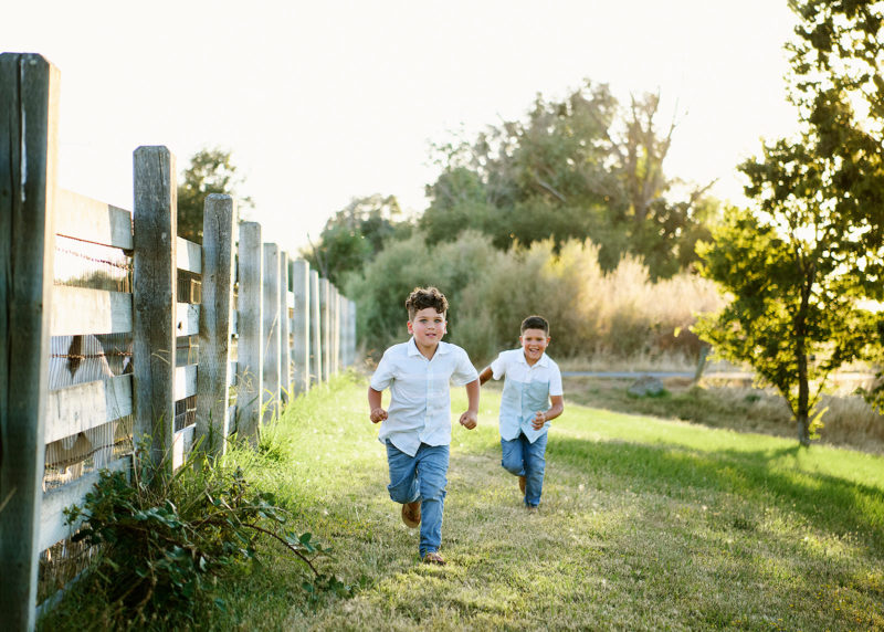 Brothers running in grass in Sacramento