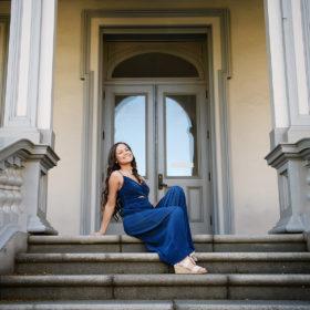 Senior girl sitting and posing on Sacramento Capitol steps