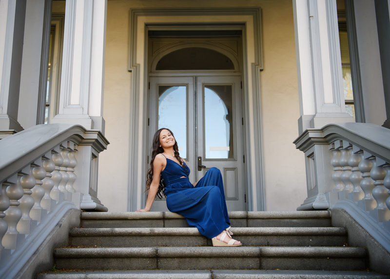 Senior girl sitting and posing on Sacramento Capitol steps