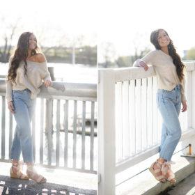 High school senior girl posing in front of Sacramento river