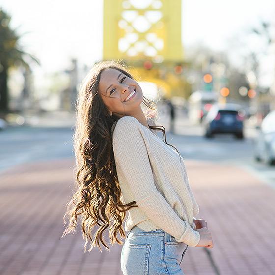 Senior girl posing in front of Tower Bridge in Sacramento