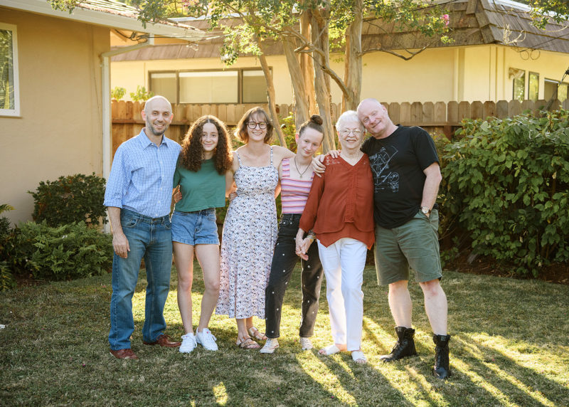 Family reunion with grandma in Sacramento outside of house on lawn