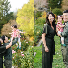 Mom and dad lift up baby daughter in the air at McKinley Park Rose Garden