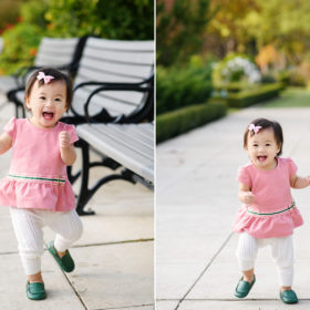 Toddler girl wearing pink running through McKinley Park and smiling