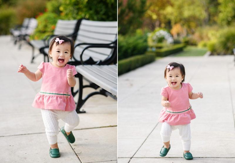 Toddler girl wearing pink running through McKinley Park and smiling