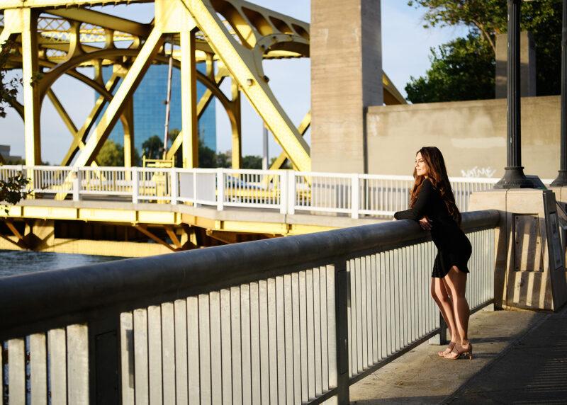 Teen girl looking at the water on Tower Bridge Sacramento