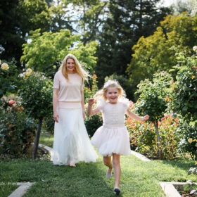 Daughter running in front of mom at McKinley Park Rose Garden Sacramento