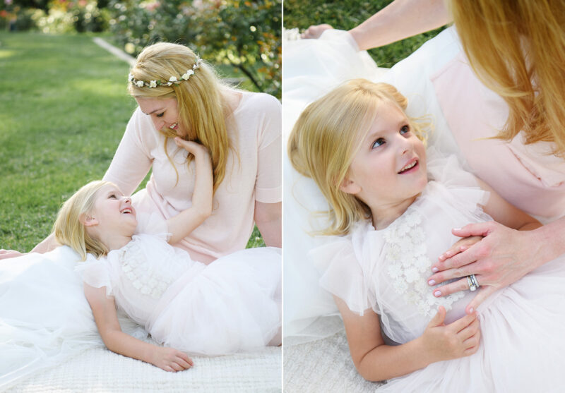 Daughter lying on mom's lap while wearing flower crown on grass at McKinley Park