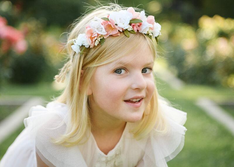Close up of girl wearing flower crown in McKinley Park Rose Garden Sacramento