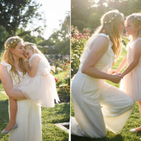 Mom holding her daughter and kissing her against sunset light at McKinley Park Rose Garden